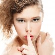 Woman with a finger on lips — Stock Photo #4273999