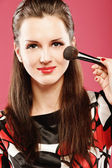 Woman applying blusher — Stock Photo
