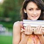 Girl-student holds textbooks — Stock Photo