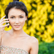 Girl speaks on phone — Stock Photo