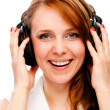 Stock Photo: Young woman listening to the music