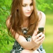 Stock Photo: Beautiful young womwith mobile phone