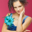 Beautiful young woman in a blue dress — Stock Photo #4968896
