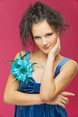 Beautiful young woman in a blue dress — Stock Photo