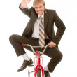 Businessman on children's bicycle — Stock Photo