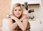 Charming girl lies on floor — Stock Photo