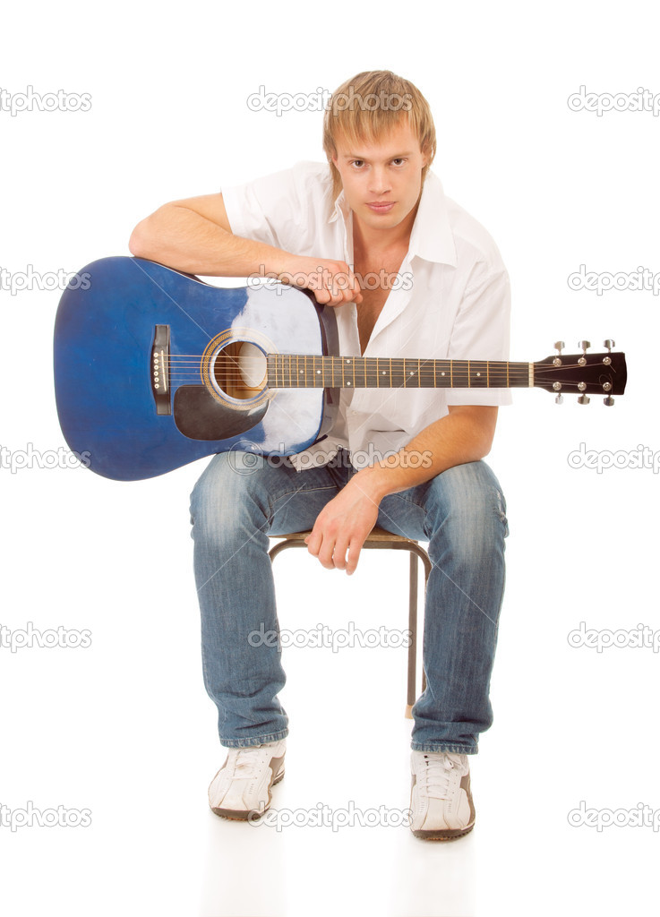 Young blond man with a guitar, isolated on a white background — Stock Photo #5010930