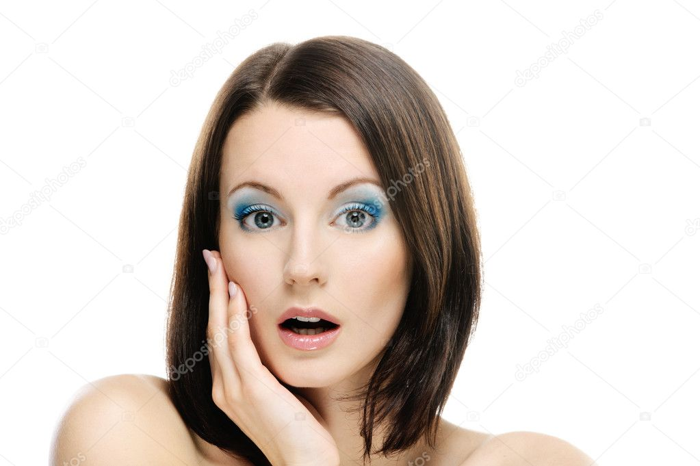 Young beautiful woman with dark hair strongly was surprised, with amazement having slightly opened mouth, on white background. — Stock Photo #5030471