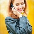 Beautiful woman talking on cell phone — Stock Photo