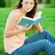 Girl-student read a textbook. — Stock Photo