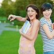 Two girl-student in the park — Stock Photo #5374629