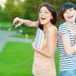 Two girl-student in the park — Stock Photo #5374635
