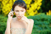 Sad woman said by cell phone — Stock Photo
