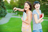Two girl-student in the park — Stock Photo