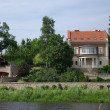 Stock Photo: House on river bank