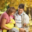 Family in autumn park — Stock Photo #3986005