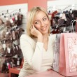 Royalty-Free Stock Photo: The woman shop and a mobile phone