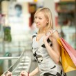 The girl with purchases — Stock Photo