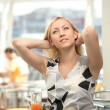 A girl is in a cafe — Stock Photo #3986742