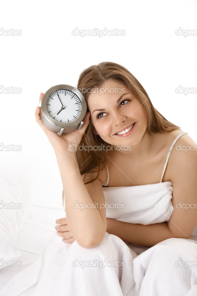 The smiling young woman with an alarm clock, isolated — Stock Photo #3985959