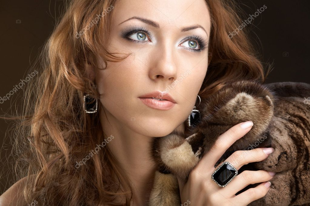 The beautiful woman in furs and jewelry — Stock Photo #3986132