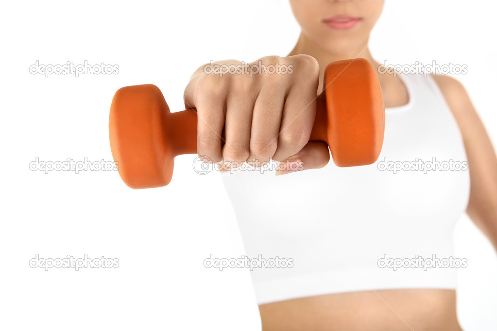 The woman trains muscles of the hands, isolated  Stock Photo #3986853