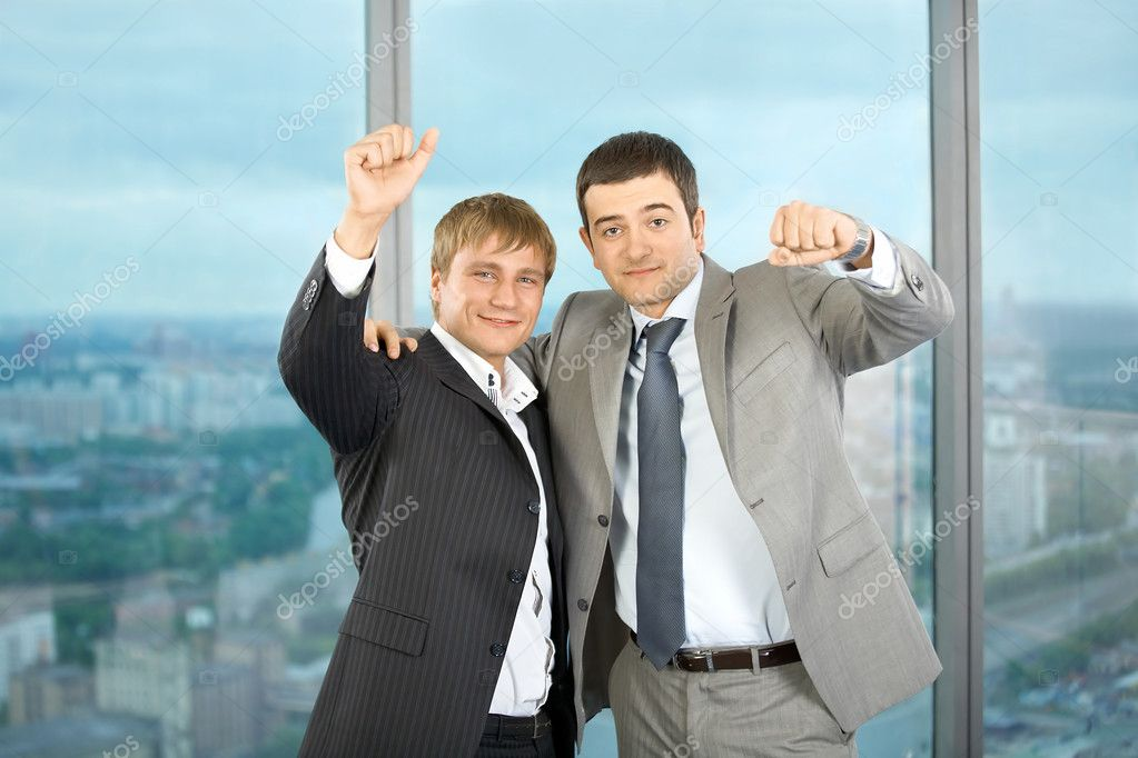 Two business men of colleagues emotionally celebrate a victory  Stock Photo #3991772