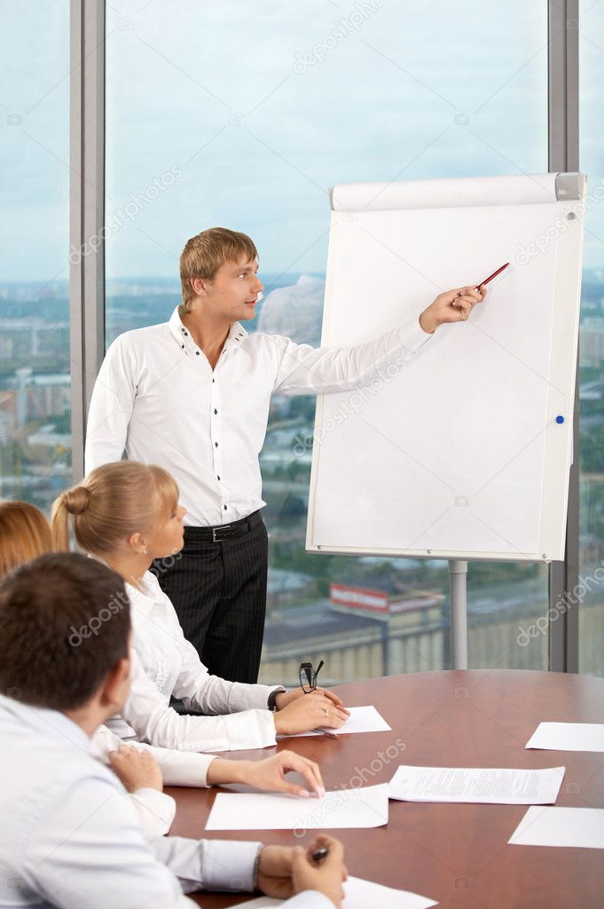 The business man shows something on a board at conference  Stock Photo #3991819