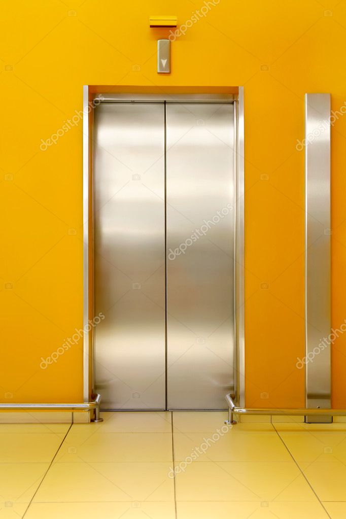 Photo of shining doors of the lift and orange walls around — Stock Photo #3991895