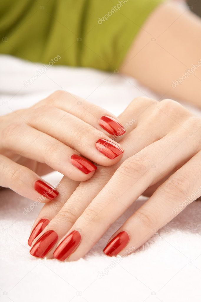 Beautiful female hands with a red varnish on nails — Stock Photo #3991911
