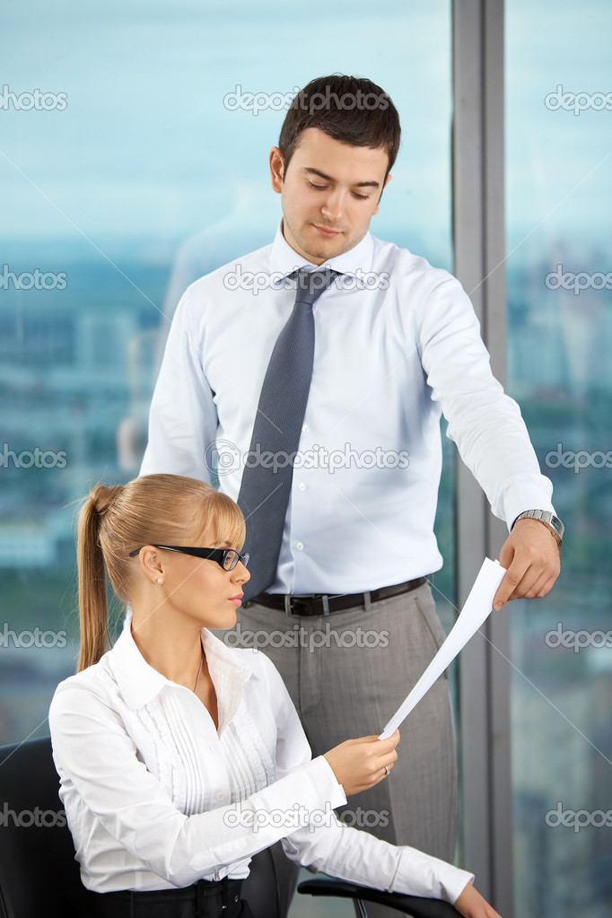 The business man gives the document to the business woman at office — Stock Photo #3996793