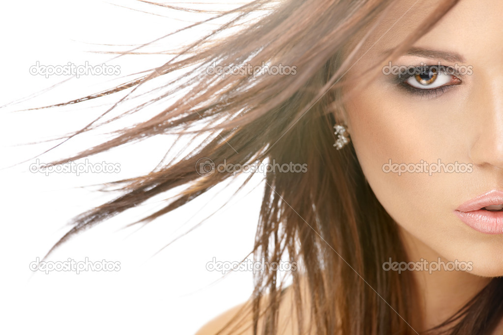 Close up - a half of face of beauty with flying hair, isolated — Stock Photo #3997836