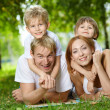 Family on a lawn — Stock Photo