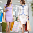 Two happy shopaholics — Stock Photo