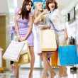 Three girls in shop — Stock Photo