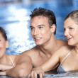 Laughing friends in pool - Stock Photo