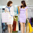 Stock Photo: Two happy shopaholics