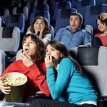 Young men at cinema — Stock Photo