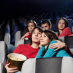 Enamoured couple at cinema — Stock Photo