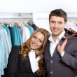 Couple in clothes shop — Stock Photo