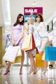 Girlfriends in shop — Stock Photo