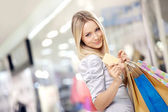 Shopping blonde — Stockfoto