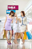 Girl-friends on shopping — Stock Photo