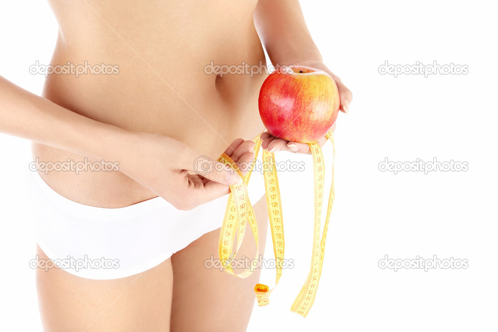 Close up of female stomach, apple and measuring tape, isolated — Foto Stock #4014087