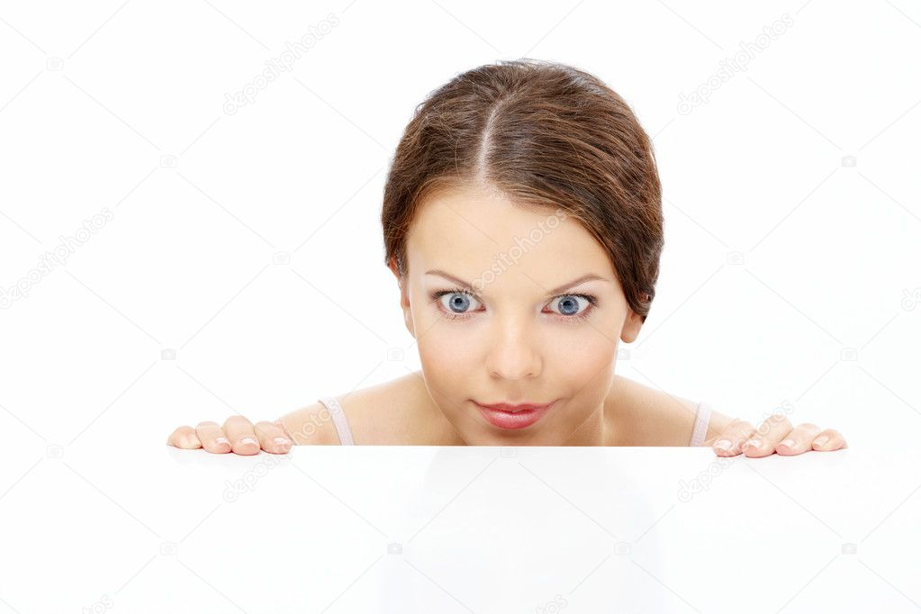 Looking out pleasantly surprised girl, isolated on a white background — Stock Photo #4014222
