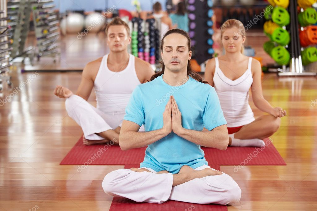 Three persons sit in a lotus pose  Foto Stock #4016295