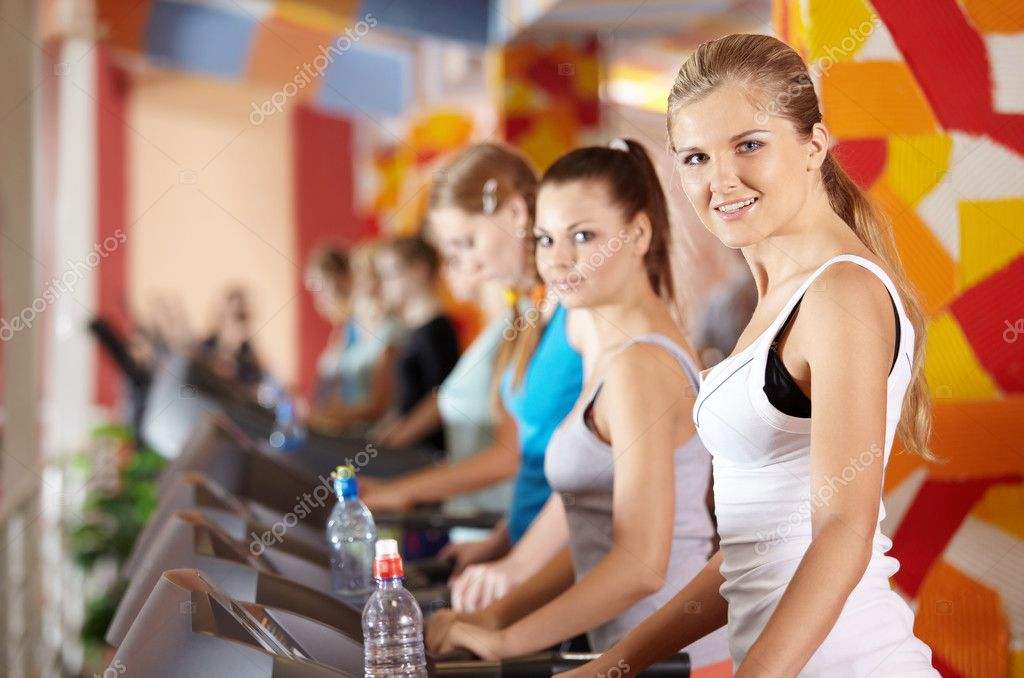 Portrait of beautiful girls on warm-up in sports hall — Stock Photo #4016392