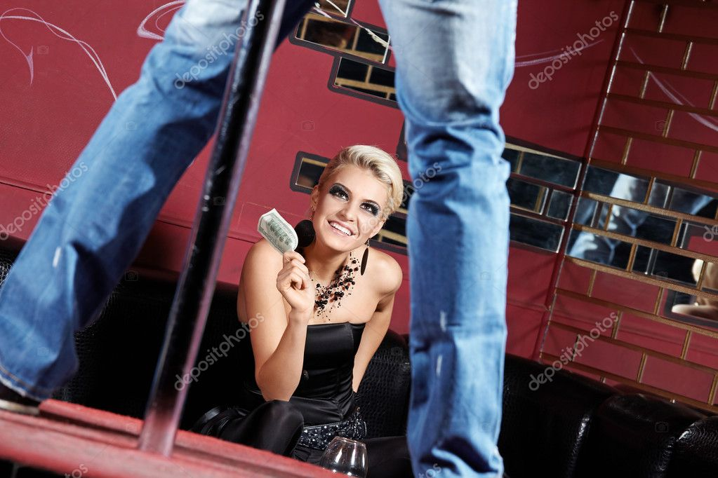 The man dances a striptease for the girl — Stock Photo #4019118