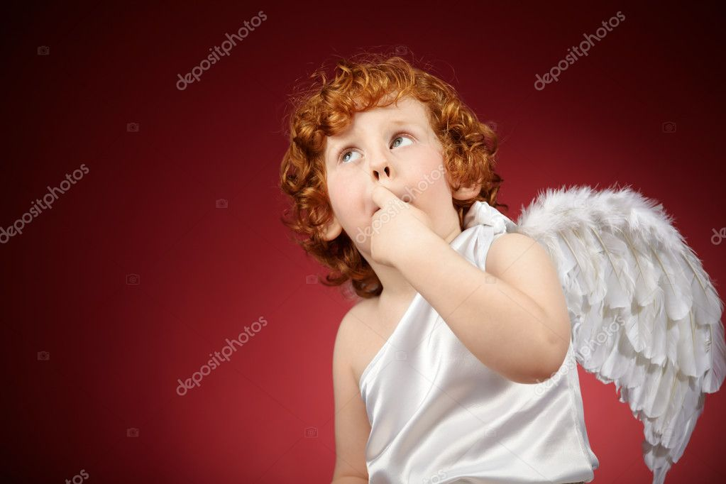 Portrait of the little boy with wings behind the back on a red background — Stock Photo #4019123