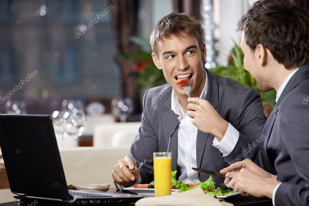 Two smiling business men eat at restaurant — Stock Photo #4019231